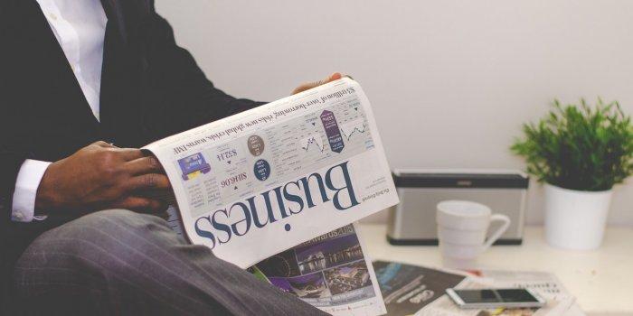 man-reading-business-newspaper
