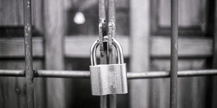 black-and-white-padlock-on-gate