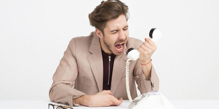 man-screaming-down-the-phone