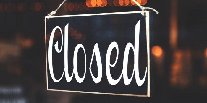 closed-sign-in-shop-door